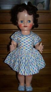 1950's BRUNETTE PEDIGREE WALKER DOLL IN LOVELY CONDITION WITH VINTAGE CLOTHING