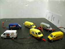 Ho scale mixed vans all with head and taillights