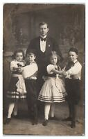 RPPC Father in Tuxedo and Kids Dance Pose in Ethnic Dress Real Photo Postcard