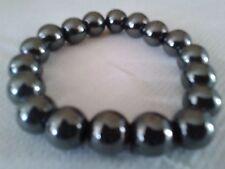 Bracelets en perles rondes d' hématite magnétique de 12 mm .