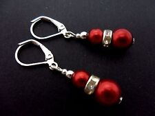 A PAIR OF DANGLY SILVER PLATED DARK RED GLASS PEARL LEVERBACK HOOK EARRINGS. NEW