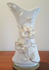 White porcelain vase decorated with golden flowers. Unusual design. Good quality