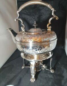 ANTIQUE HIGHLY DECORATIVE SPIRIT KETTLE ON A 4 CLAWED STAND WITH BURNER