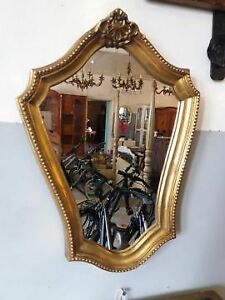 A vintage ,gold wall mirror