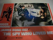 Roger Moore    signed  Spy Who Loved Me  lobby card   w/COA
