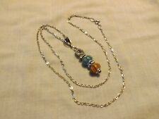 Pendant necklace with blue and tiger eye glass beads
