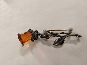 broche formant une rose en ambre  6,05 Grammes 5,2cm haut