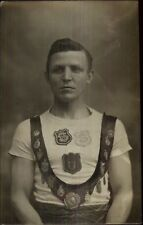 Man w/ Sash Medals & Badges War or Sports Hero? UK c1910 Real Photo Postcard