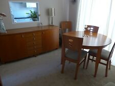 dining table and six chairs and sideboard