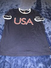 USA 2004 ATHENS OLYMPIC ROOTS OFFICIAL OUTFITTER RINGER T SHIRT LADIES SIZE M