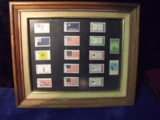 NICE PICTURE FRAME WITH SOME OLDER UNITED STAMPS MOUNTED IN IT. WAY KEWL.