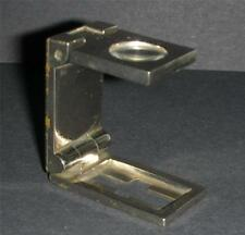 Old small chrome plated freestanding magnifier .