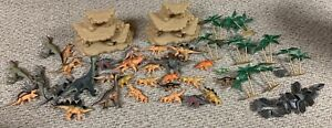 ANIMAL PLANET 67 PC MEGA DINO BAG FIGURES DINOSAUR SET TOYS R US ( NOT COMPLETE)