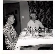 Older Couple Sitting at Dining Room Table - Vintage 1958 B&W Photograph