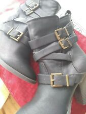 Women Candies dark brown heeled boots with straps and buckles.   7 1/2 M
