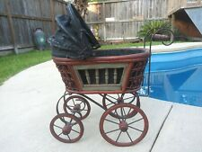 Vintage doll carriage with wood handle