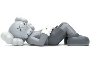 Kaws Holiday Japan Vinyl Figure - Gray Toy Limited.