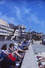 Vintage photo slide 1985 - 2 women showing their legs on Cannes beach walk