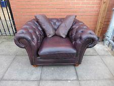 A Dark Brown Leather Chesterfield Club/Arm Chair