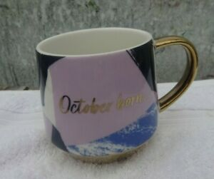 Mug John Lewis Called October born to cause a storm gold purple & mauve  boxed