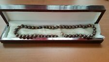 Culture Pearl Necklace. 14 kt. gold clask. With rose wood box. (chocolate color)