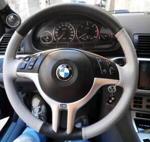 Coprivolante BMW E46 vera pelle nera e grigia