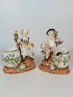 A Pair Of Minton Figural Spill Vases Of A Boy And Girl Seated By Floral Encruste