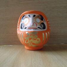 small Daruma Doll in orange color with a pen / Daruma at Takasaki : No 1 size