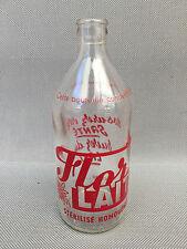 ancienne petite bouteilles en verre de lait Flor lait publicitaire