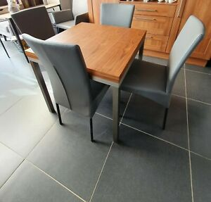 Walnut Extending dining table and 6 grey chairs used