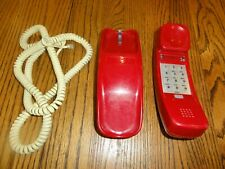 Old push button dial Trimline phone in Red.