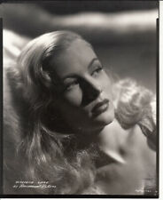 Veronica Lake lays against a pillow Photo From Original Negative