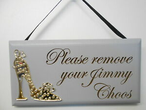 Please remove your Jimmy  Choos, plaque, Gold mirror shoe, grey.