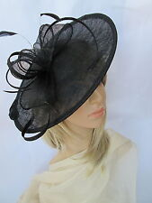 Black Feather Fascinator ..on a headband.Shaped saucer disc ,Wedding..races..new