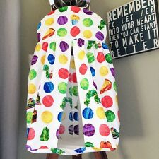A bespoke nappy stacker made in The very hungry caterpillar fabric