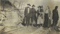 Stone Kentucky Coal Miners Family Posing on Mine Cart Tracks 1910s Vintage Photo
