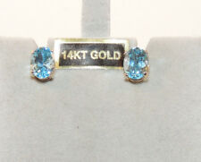 14k Gold and sky Blue Topaz Post Earrings (12870)