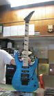 USED JACKSON DINKY ELECTRIC FLOYD ROSE TREMOLO GUITAR WITH NO CASE.