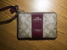 Coach wallet wrist let, maroon, great condition, many pockets, working zipper...