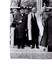 Gov. Nelson Rockefeller greets a crowd in front of new Olsen Mun.  AP News Photo