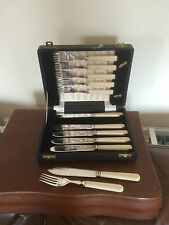 CASED SET OF 12 SILVER PLATED FISH KNIVES AND FORKS IN A BLACK FAUX CASE (FK749)