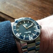 oris aquis date blue dial, blue ceramic bezel, sapphire. steel bracelet 43mm
