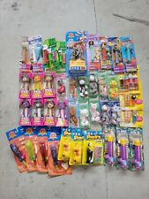 Lot of Pez Dispensers and pez items, Star Wars, Disney, Looney Tunes