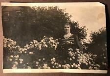 Vintage photo Roses Woman standing in garden black & white