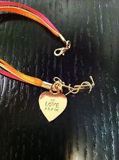YSL Yves Saint Laurent In Love Again Ribbon Charm Goldtone Bracelet FREE SHIP