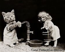 A Doll and a Kitten Pumping Water - 1915 - Historic Photo Print