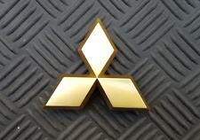 OEM Mitsubishi Body/Dash/Trunk Emblem. RARE gold color. 7.6cm