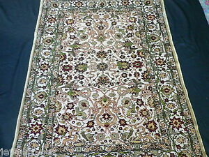 SIGNED TURKISH HEREKE SILK RUG
