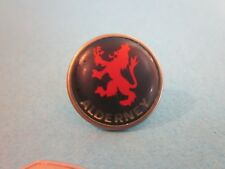 Metal & Enamel Pin Badge. Alderney with Red Lion. Good Used Condition