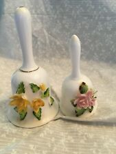 2 porcelain bells applied yellow flowers and applied pink flowers. Yellow 5.25